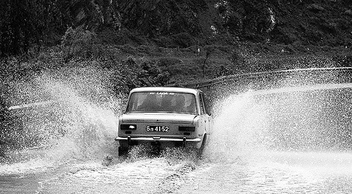 18430732-lada-car-splashing-water-road-bulgaria